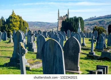 Gravestones in a sunny church graveyard