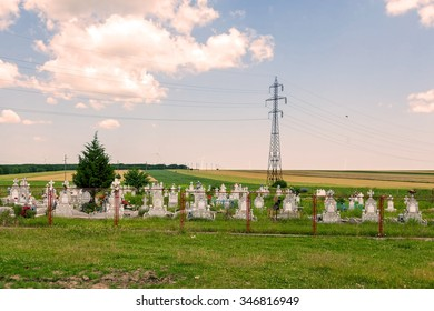 Graveyard In Calarasi County In The Foothills Of The Wind Turbines, Romania, East Europe