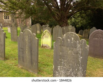 Graveyard with green tombstone