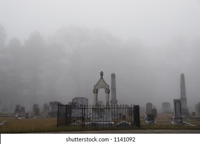 Graveyard on a foggy morning