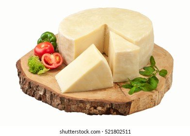 Graviera greek cheese on natural piece of wood.Clipping path.