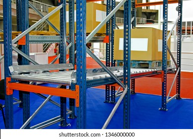 Gravity Flow Conveyor at Shelving System in Distribution Warehouse