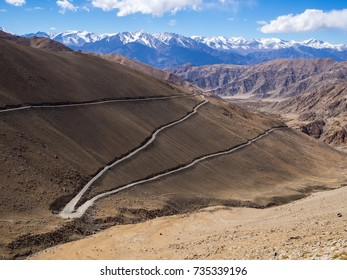 A gravity hill and Khardung La Highest highway and dangerous road of the world pass to the Pangong lake on mountain with blue sky, Leh Ladakh. India.