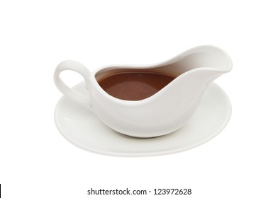 Gravy in a gravy boat isolated against white
