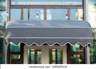 Gray awning in front of shop