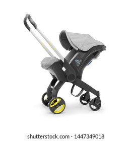 Gray Baby Stroller Isolated on White Background. Baby Transport. Travel System with Canopy and Swivel Front Wheels. Side View Infant Carriage Seat. Pushchair Pram with Adjustable Showerproof Hood