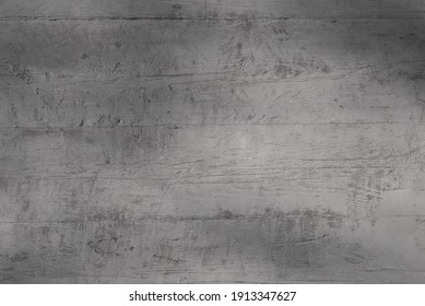 gray background. in the photo, a gray wooden wall of an old building, close-up