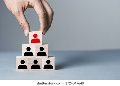 Gray background with wooden blocks of people silhouettes