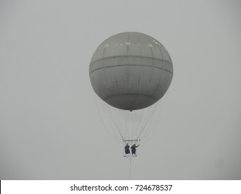 Gray balloon on a gray sky