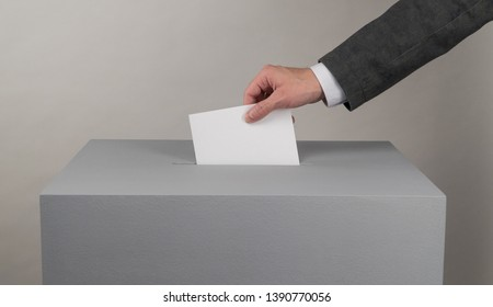 Gray ballot box. Presidential and parliamentary elections. The voter throws the ballot into the ballot box.