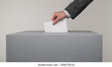 Gray ballot box. Presidential and parliamentary elections. The voter throws the ballot into the ballot box.