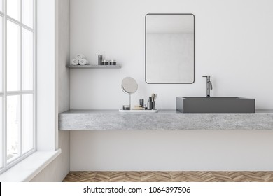 Gray bathroom sink with a mirror hanging above it in a white wall bathroom. A make up shelf and mirror. 3d rendering