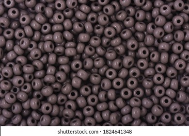 Gray Beads on the white background. Background or texture of beads. Close up, macro,It is used in finishing fashion clothes. make bead necklace or string of beads for woman of fashion.