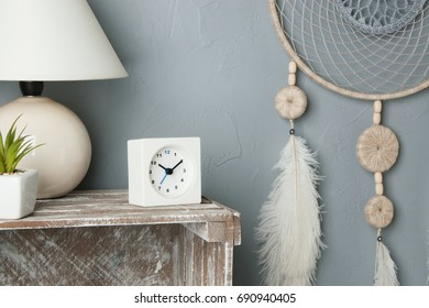 Gray beige dreamcatcher in bedroom interior on gray textured background. Bedroom decor
