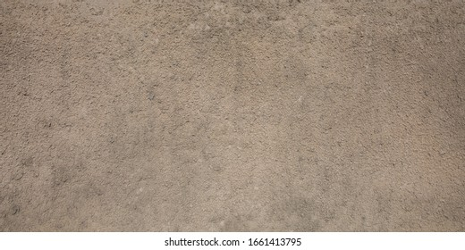 gray beige porous granular wall background texture with paint color rough surface plaster