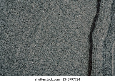 gray and black grain stone wall texture background