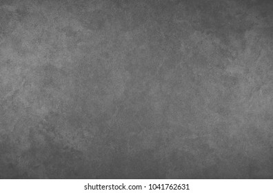 A gray black wall for inscriptions. Graphite wall. Wall for ads. Blackboard.