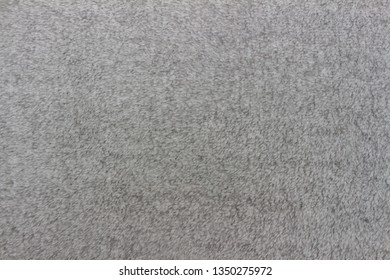 Gray blanket texture for background. Close-up of natural warm wool coverlet, wrap, coverlid. Original pattern