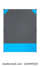 Gray and blue nylon beach blanket isolated on white background with visible corner pockets. Very thin and waterproof tarp or footprint for outdoor activities. Clipping path included.