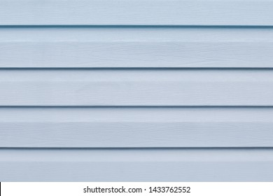 Gray blue wooden table in lines. Striped panel, surface, background. Soft grey wooden slats texture. Plank - timber. Light blue painted wood boards. Abstract pattern of logs. Copy space.