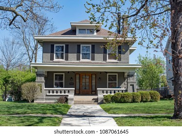 Gray Brick Craftsman Style House with Open Porch