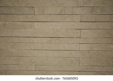 Gray brick wall background.