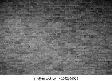 Gray brick wall in the retro style. Old but not obsoleted. Copy space for editing and text, minimal style, background and wallpaper image. Odie but goodie.