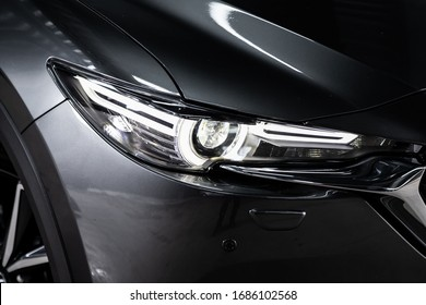 Gray car headlights. Exterior detail. Close up detail on one of the LED headlights modern car.