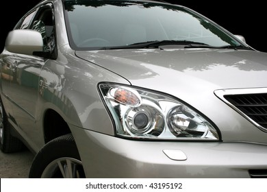 Gray car with light reflection.