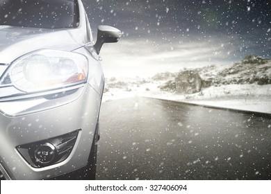 gray car and winter road