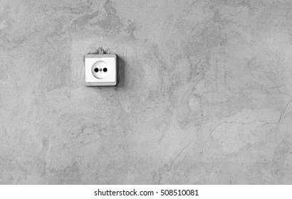 Gray cement concrete wall background with socket rosete
