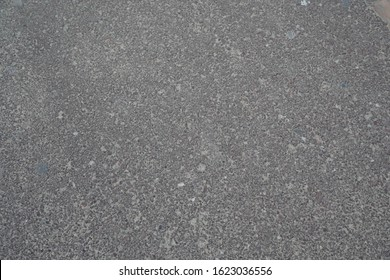 Gray Cement Gravel texture. Abstract background, Gravel texture or gravel background. Granite gravel of macadam, Rock gray crushed for construction on the ground.