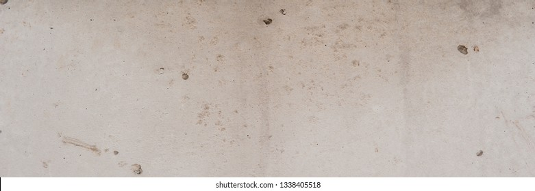 gray cement plaster on the wall of the house. Web banner.
