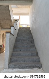 Gray Cement Stairs With Cement Railing