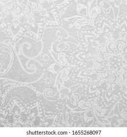 Gray ceramic tile with floral pattern for wall and floor decoration. Concrete stone surface background. Texture with ornament for interior design project.