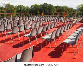 Gray chairs on red carpet