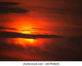 The Gray Cloud Obscure The Yellow Sun Shining in The Red Sky