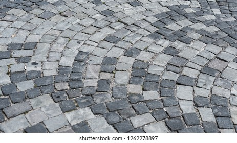 Gray cobblestone pavement on the street texture as background image