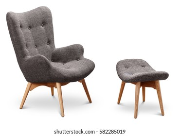 Photo of Gray color armchair and small chair for legs. Modern designer armchair on white background. Textile armchair and chair. Series of furniture.