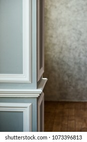 Gray column with white molding. Texturized grey putty. Vintage or grungy background of venetian stucco texture as pattern wall.