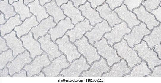 Gray concrete pattern block pavement texture background in square seamless pattern, empty space, top view, can use for background, wallpaper, interior, web design template