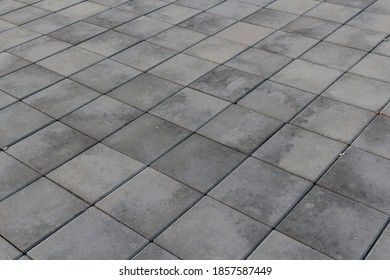 Gray concrete tiles in perspective