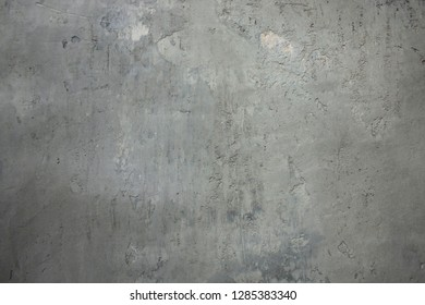 The gray concrete wall with lots of rough and uneven. Abstract background