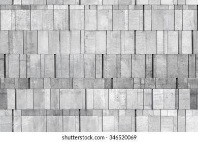 Gray concrete wall made of different size blocks, seamless background photo texture