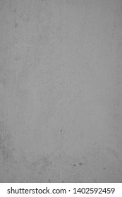 Gray concrete wall with plastered structures and soiling in industrial design. Pastel-colored stone wall with as background and design element for artful collagen. Textured wall in portrait format.