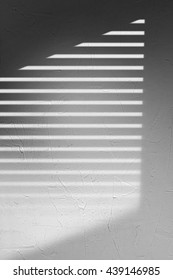 Gray Concrete Wall With Triangle and Blinds Shadow Texture