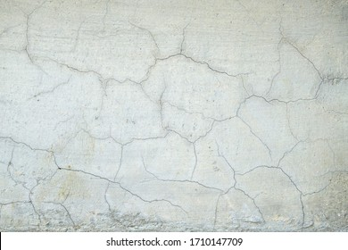 Gray cracked concrete walls with grunge, abstract background for design.