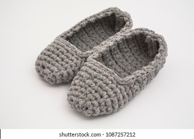 gray crocheted slippers