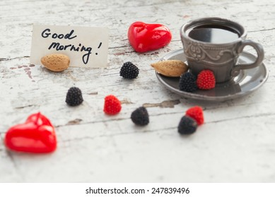 Gray cup of coffee with some sweets and Good morning note, for the St Valentine's day