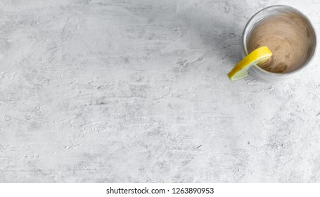 gray cup on a gray textured background